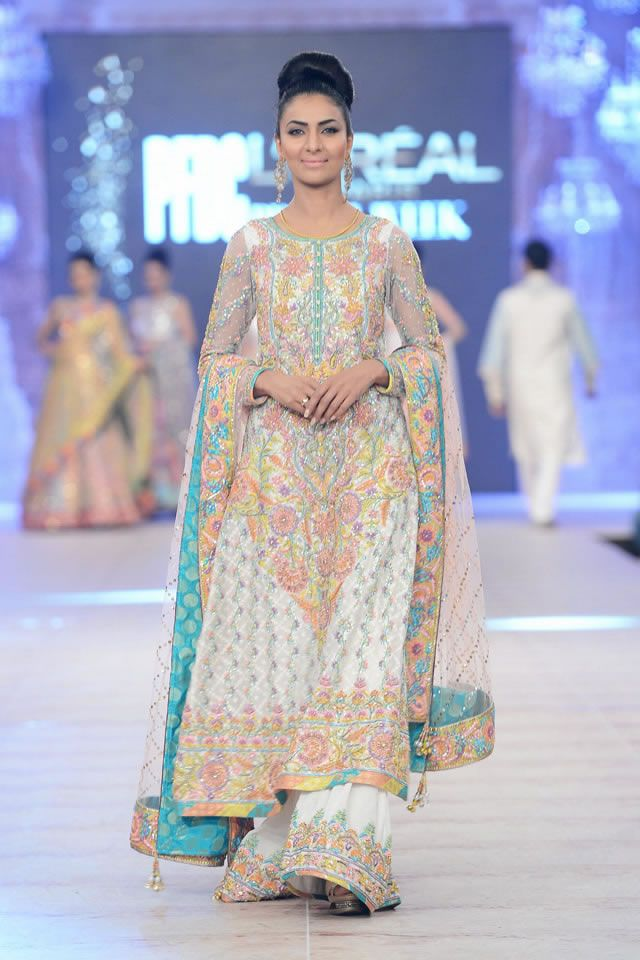 Mehndi Party Dresses 2016 : New mehndi dresses for bride by pakistani designers